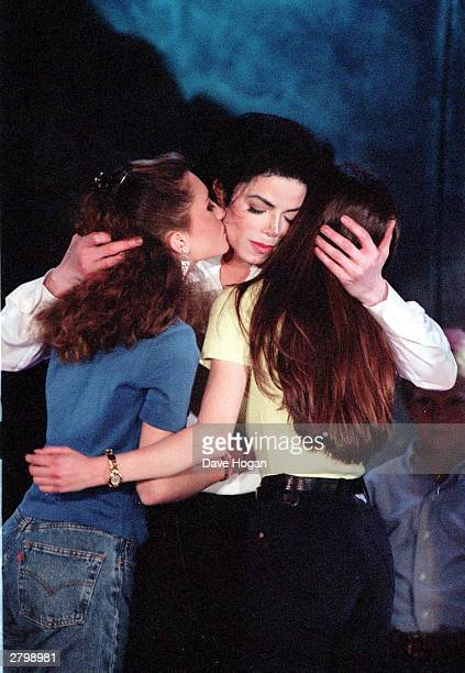 Michael Jackson with children on stage while singing 'The Earth Song' on the 'Heal the World Tour' held in Munich during 1997