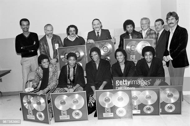 Michael Jackson with The Jacksons receiving gold record awards for Michael's 'Off The Wall' album backstage with CBS record executive Don Dempsey and...