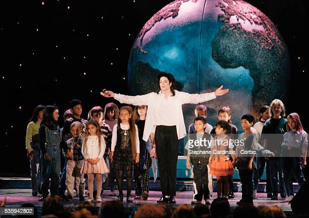 Michael Jackson with young fans on stage