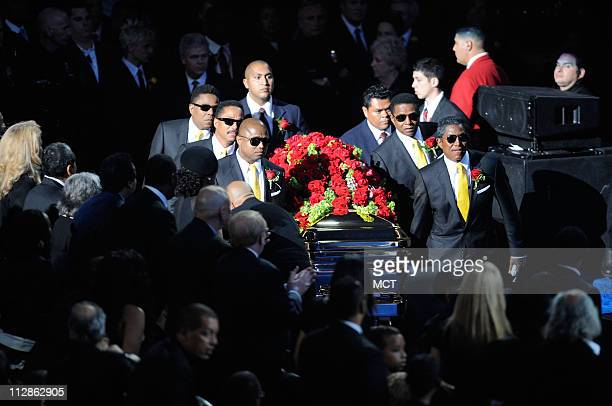 Michael Jackson's casket is brought out at the public memorial service held at the Staples Center in Los Angeles California Tuesday July 7 2009