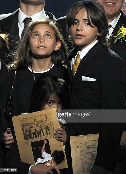 Michael Jackson's children from left Paris Michael Katherine Jackson Prince Michael Jackson II and Prince Michael Jackson I stand during a memorial...