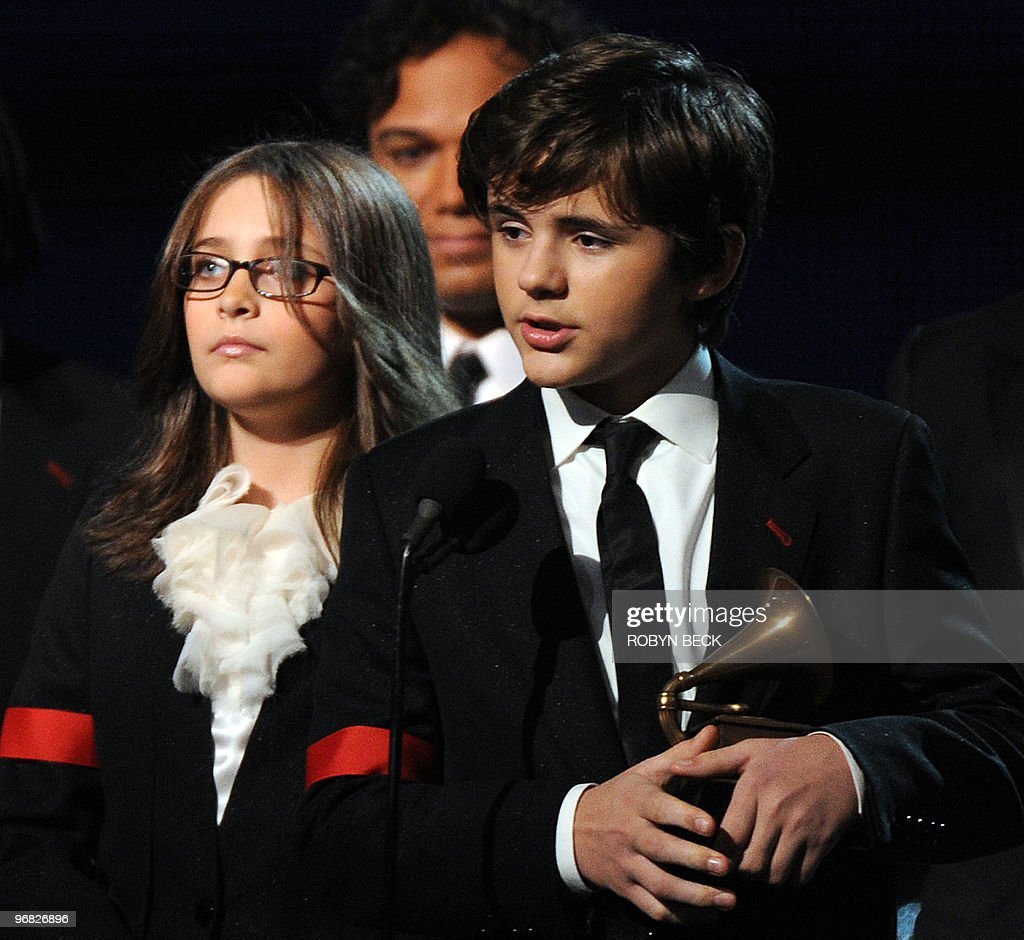 Michael Jackson's children Prince (R) and Paris accept their father's Lifetime Achievement Award at the 52nd annual Grammy Awards in Los Angeles on January 31, 2010.