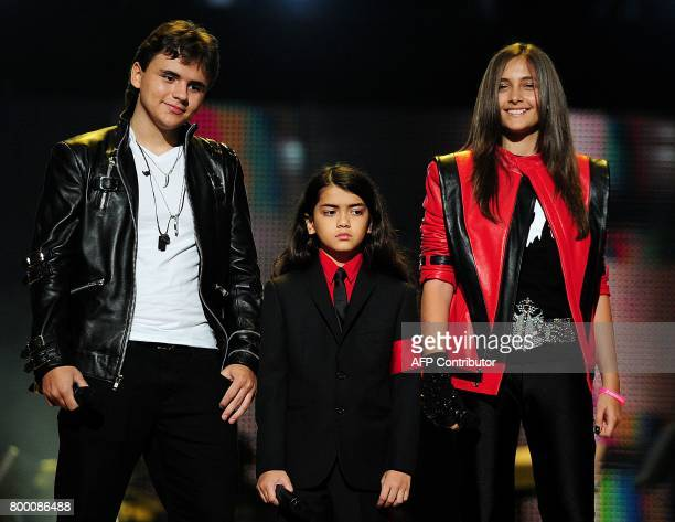 Michael Jackson's children Prince Jackson Blanket Jackson and Paris Jackson speak on stage during the 'Michael Forever' concert in memory of the late...