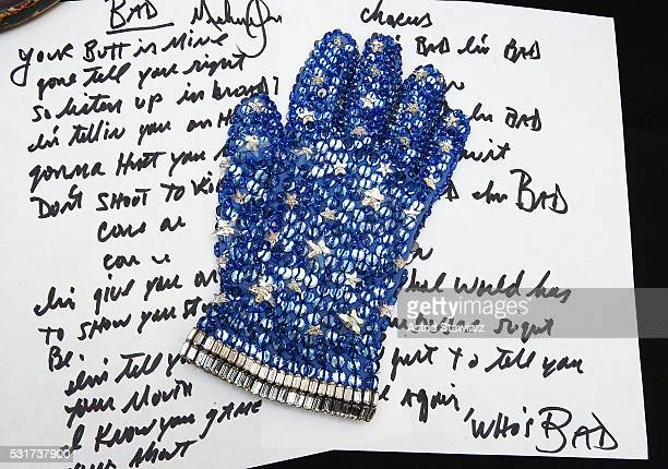 Michael Jackson's crystal glove from the 1988 film 'Moonwalker' and handwritten lyrics for the song 'Bad' are displyed during Julien's Auction Music...