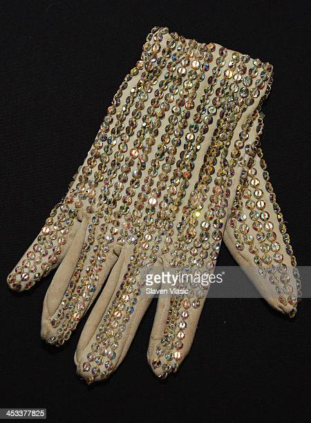 Michael Jackson's custom righthand rehearsal glove created by Tompkins and Bush with Swarovski loch rosen crystals on back on display at 'Icons Idols...
