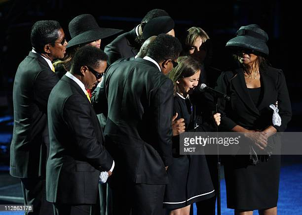 Michael Jackson's daughter Paris cries as she attempts to speak and is consoled by Jackson's siblings Jermaine La Toya Jackie Janet Randy Marlon Tito...