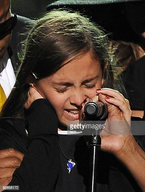 Michael Jackson's daughter Paris cries as she speaks at the memorial service for her father at the Staples Center in Los Angeles on July 7 2009 AFP...