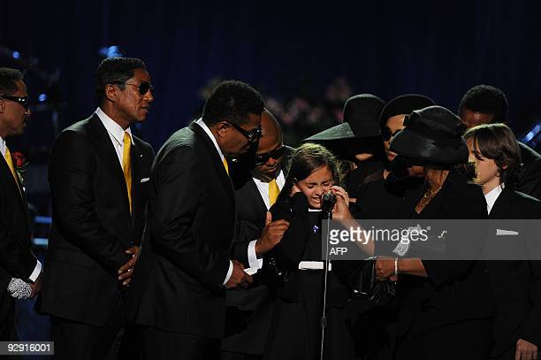 Michael Jackson's daughter Paris is comforted by family members at a memorial service for the music legend at the Staples Center in Los Angeles on...