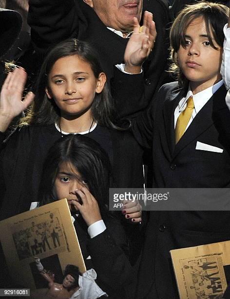 Michael Jackson's daughter Paris Michael Katherine Jackson and two sons Prince Michael Jackson II and Prince Michael Jackson I wave at the end of a...