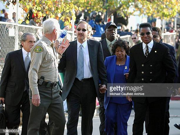 Michael Jackson's defense attorney Mark Geragos and Jackson's mother and brother Katherine and Jermaine holds hands as they arrive at the courthouse...