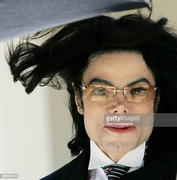 Michael Jackson's hair flies in the wind as he departs the Santa Barbara County courthouse April 29 in Santa Maria California as court is adjourned...