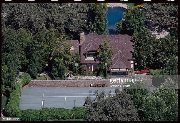 Michael Jackson's house on Neverland Ranch overlooks a tennis court Neverland is located in the Santa Ynez Valley in Santa Barbara County California