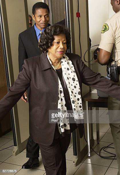 Michael Jackson's mother Katherine Jackson and brother Jackie Jackson pass through security as they arrive for Jackson's child molestation trial at...