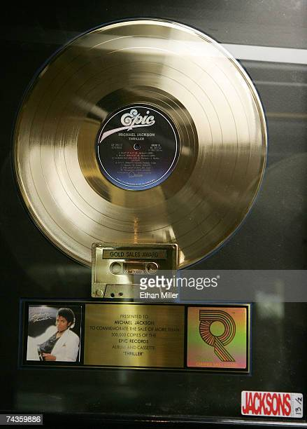 "Michael Jackson's RIAA certified gold LP commemorating the sale of 500,000 copies of his album, ""Thriller"" is displayed during a preview for an..."