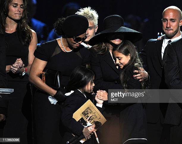 Michael Jackson's sisters Janet Jackson and LaToya Jackson comfort his children Paris and Prince Michael II at the Staples Center in Los Angeles...