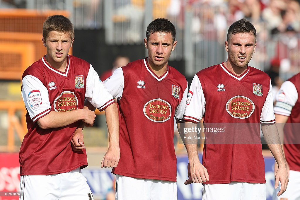 Michael Jacobs, George Baldock and Arron Davies of Northampton Town line up to defend a free kick during the npower League two match between Barnet and Northampton Town at Underhill Stadium on October 1, 2011 in Barnet, England.