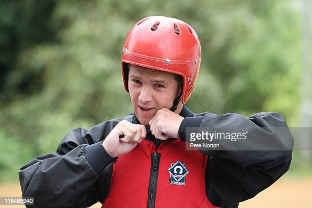 Michael Jacobs of Northampton Town adjusts his crash helmet during a training session at Nene Whitwater Centre on July 7, 2011 in Northampton,...