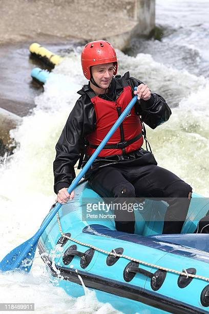 Michael Jacobs of Northampton Town goes water rafting during a training session at Nene Whitewater Centre on July 7, 2011 in Northampton, England.