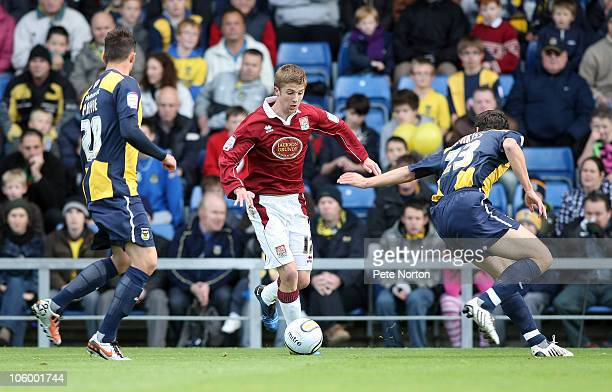 Michael Jacobs of Northampton Town looks to move between Ben Purkiss and Josh Payne of Oxford United during the npower League Two match between...