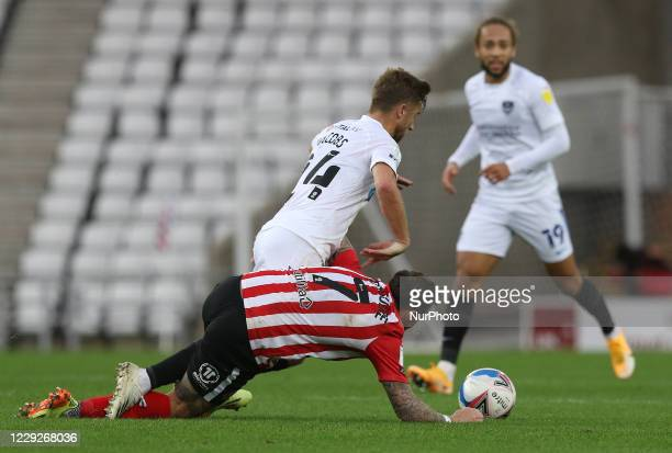 Michael Jacobs of Portsmouth is challenged by Chris Maguire of Sunderland during the Sky Bet League 1 match between Sunderland and Portsmouth at the...