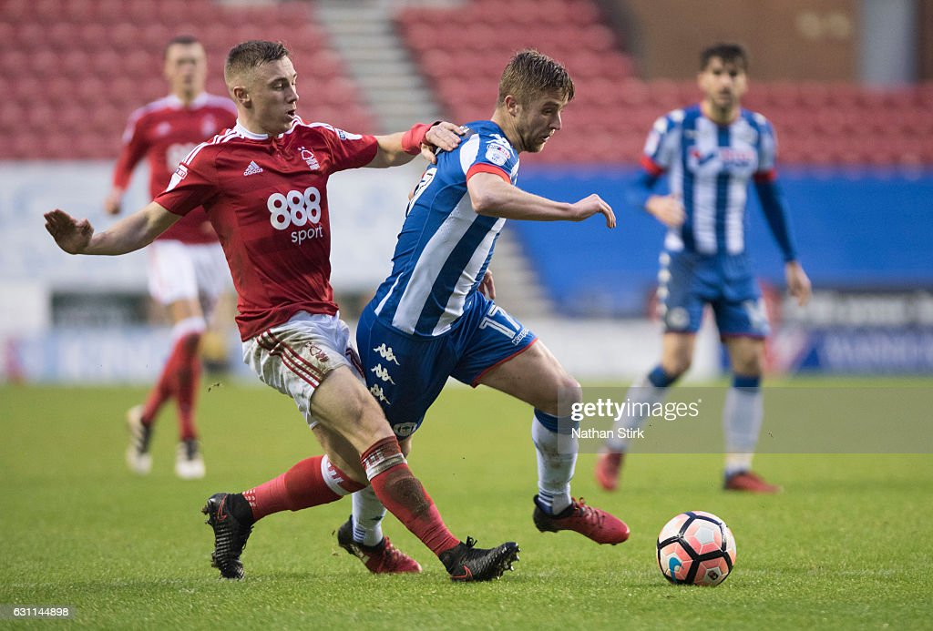 Michael Jacobs of Wigan Athletic and Ben Osborn of Nottingham Forest in action during the Emirates FA Cup Third Round match between Wigan Athletic and Nottingham Forest at the DW Stadium on January 7, 2017 in Wigan, England (Photo by Nathan Stirk/Getty Images).