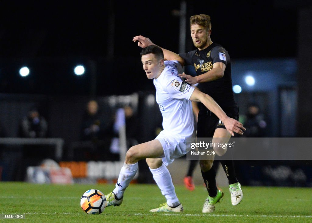 Michael Jacobs of Wigan Athletic and George Edmundson of AFC Fylde in action during The Emirates FA Cup Second Round match between AFC Fylde and Wigan Athletic on December 1, 2017 in Kirkham, England.