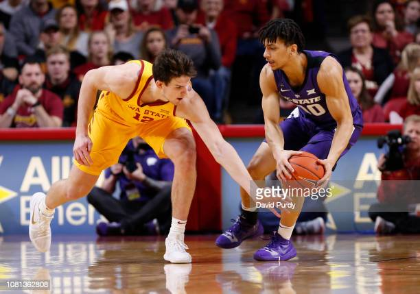 Michael Jacobson of the Iowa State Cyclones battles for the ball with Mike McGuirl of the Kansas State Wildcats in the first half of play at Hilton...