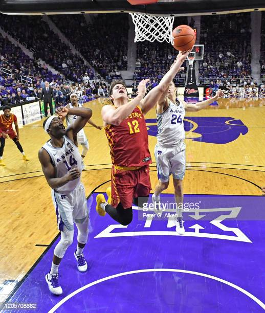 Michael Jacobson of the Iowa State Cyclones drives to the basket against Makol Mawien of the Kansas State Wildcats during the second half at Bramlage...