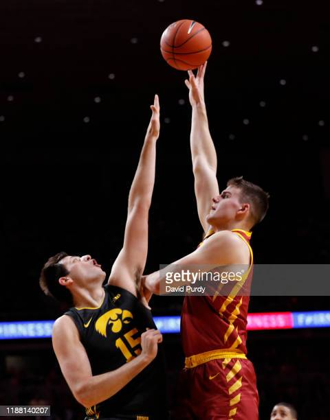 Michael Jacobson of the Iowa State Cyclones takes a short over Ryan Kriener of the Iowa Hawkeyes in the first half of their game at The Hilton...