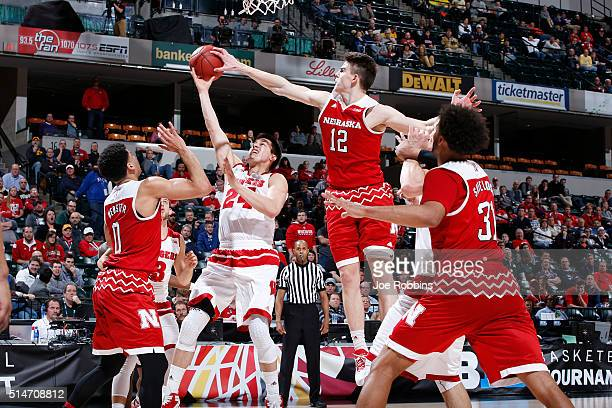 Michael Jacobson of the Nebraska Cornhuskers blocks a shot against Bronson Koenig of the Wisconsin Badgers in the second round of the Big Ten...