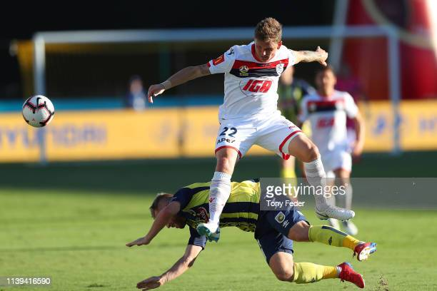 Michael Jakobsen of Adelaide United contests the ball with Connor Pain of the Central Coast Mariners during the round 23 ALeague match between the...