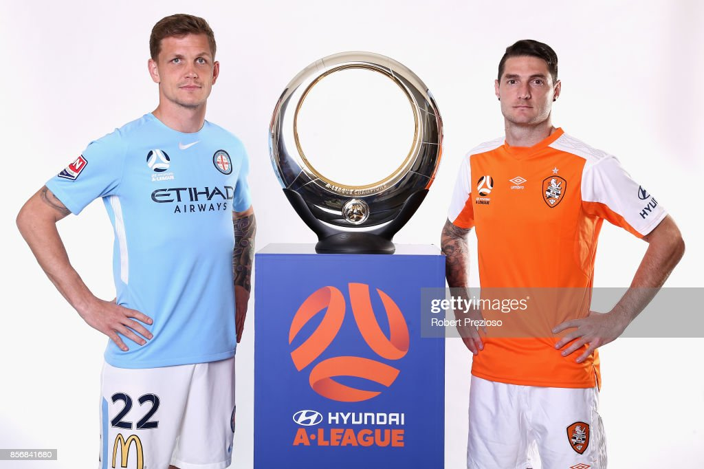 Michael Jakobsen of Melbourne City and Corey Gameiro of Brisbane Roar pose during the 2017/18 A-League Season Launch at Port Melbourne SC on October 3, 2017 in Melbourne, Australia.