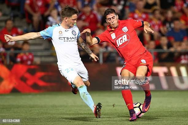 Michael Jakobsen of Melbourne City and Sergio Guardiola of Adelaide United compete for the ball during the round 15 ALeague match between Adelaide...