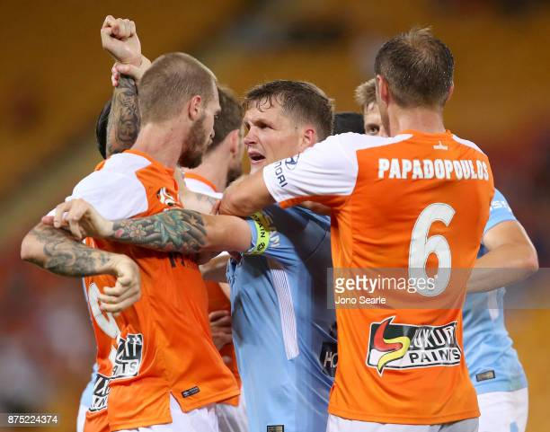 Michael Jakobsen of Melbourne City argues with Brisbane players during the round seven ALeague match between Brisbane Roar and Melbourne City at...