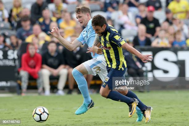 Michael Jakobsen of Melbourne City is constested by Asdrubal of the Mariners during the round 16 ALeague match between the Central Coast Mariners and...
