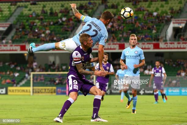 Michael Jakobsen of Melbourne contests a header against Andy Keogh of the Glory during the round 21 ALeague match between the Perth Glory and...