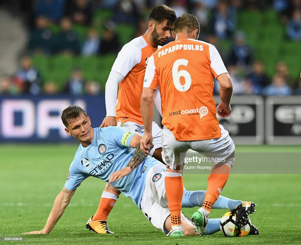 Michael Jakobsen of the City attempts to pass the ball during the round one A-League match between Melbourne City FC and the Brisbane Roar at AAMI Park on October 6, 2017 in Melbourne, Australia.