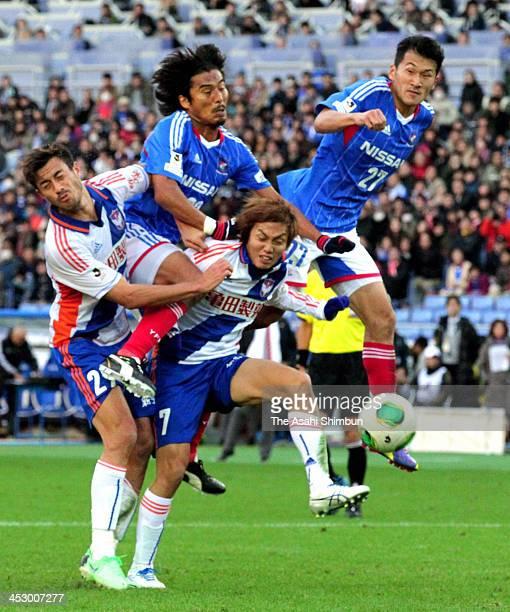 Michael James Fitzgerald and Seiya Fujita of Albirex Niigata and Yuji Nakazawa and Seitaro Tomisawa of Yokohama FMarinos compete for the ball during...