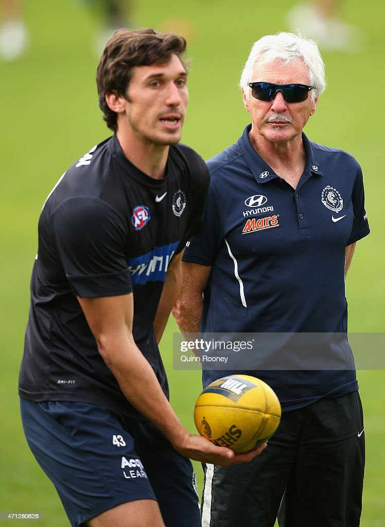 Michael Jamison of the Blues talks to Mick Malthouse the coach of the Blues during a Carlton Blues AFL media session at Ikon Park on April 27, 2015 in Melbourne, Australia.
