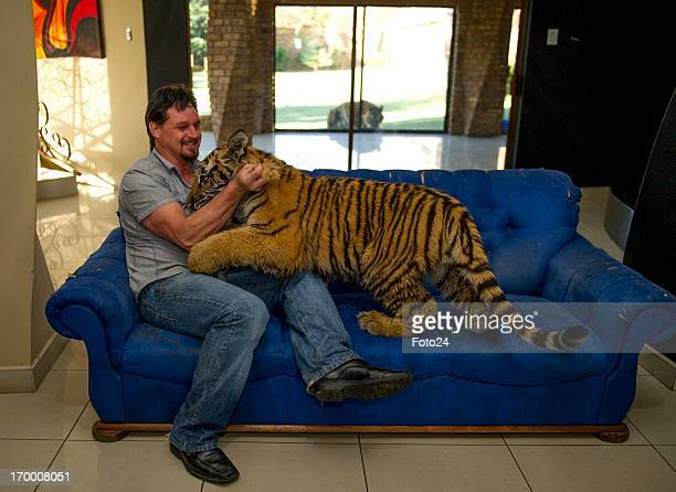 Michael Jamison with Ozzy on May 31 in Brakpan South Africa Jamison adopted Ozzy in addition to his 15 dogs and 2yearold Bengal tiger Ozzy has...
