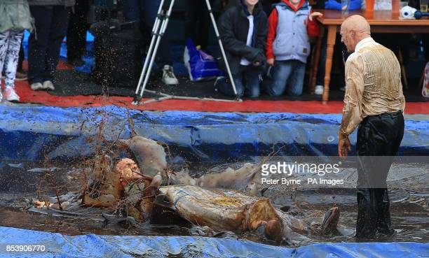 Michael Jarrett celebrates his victory over Brian Gumbley as they take part in the World Gravy Wrestling Championships at the Rose n Bowl Stackteads...