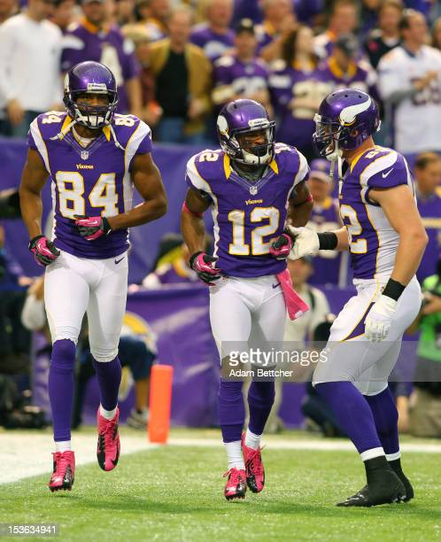 Michael Jenkins Percy Harvin and Kyle Rudolph of the Minnesota Vikings celebrate Harvin's touchdown against the Tennessee Titans at the Hubert H...