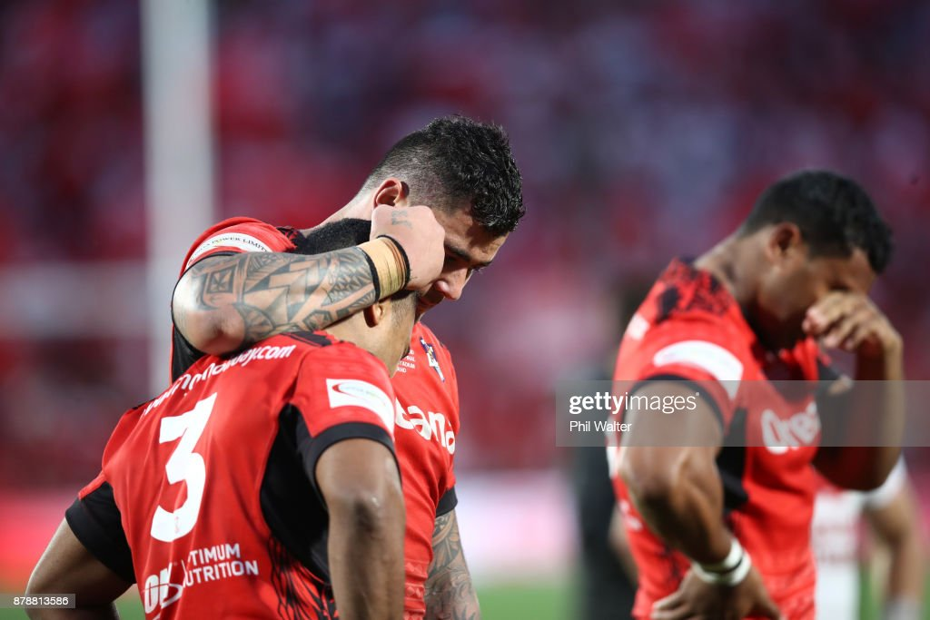 Michael Jennings and Andrew Fifita of Tonga console each other following the 2017 Rugby League World Cup Semi Final match between Tonga and England at Mt Smart Stadium on November 25, 2017 in Auckland, New Zealand.