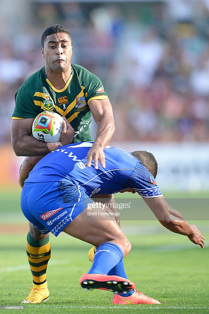 Michael Jennings of Australia is tackled during the Four Nations match between the Australian Kangaroos and Samoa at WIN Stadium on November 9, 2014 in Wollongong, Australia.
