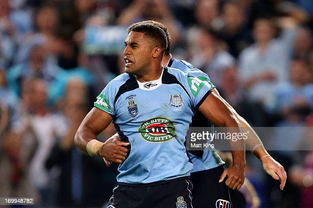Michael Jennings of the Blues celebrates scoring a try during game one of the ARL State of Origin series between the New South Wales Blues and the...