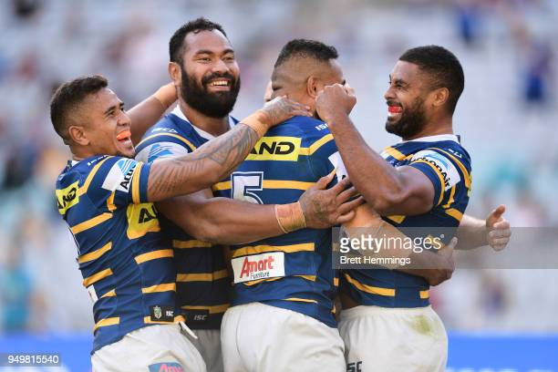 Michael Jennings of the Eels celebrates scoring a try with team mates during the round seven NRL match between the Parramatta Eels and the Manly Sea...