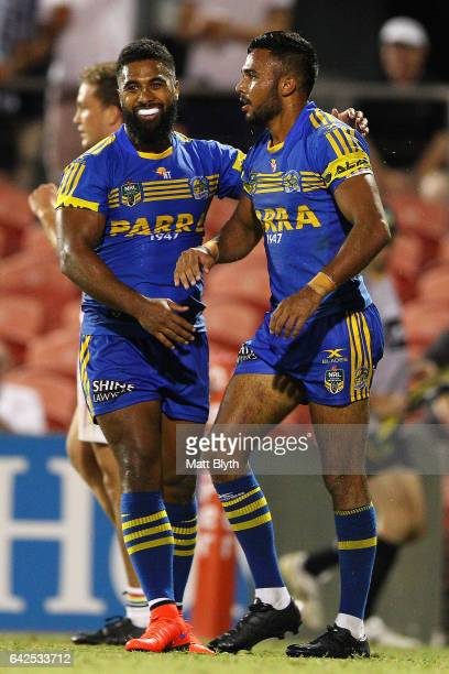 Michael Jennings of the Eels congrtulates Bevan French of the Eels after scoring a try during the NRL Trial match between the Penrith Panthers and...