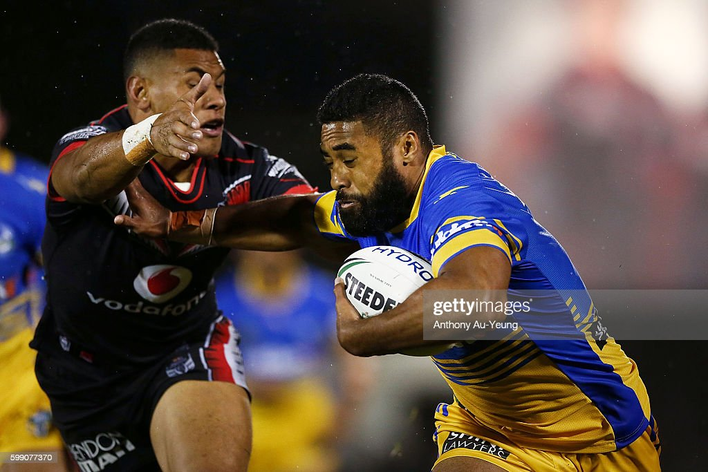 Michael Jennings of the Eels fends against David Fusitu'a of the Warriors during the round 26 NRL match between the New Zealand Warriors and the Parramatta Eels at Mt Smart Stadium on September 4, 2016 in Auckland, New Zealand.