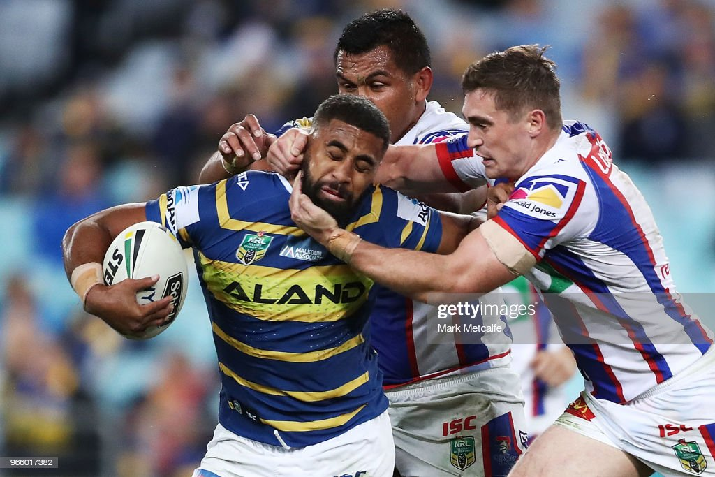 Michael Jennings of the Eels is tackled by Connor Watson of the Knights during the round 13 NRL match between the Parramatta Eels and the Newcastle Knights at ANZ Stadium on June 2, 2018 in Sydney, Australia.