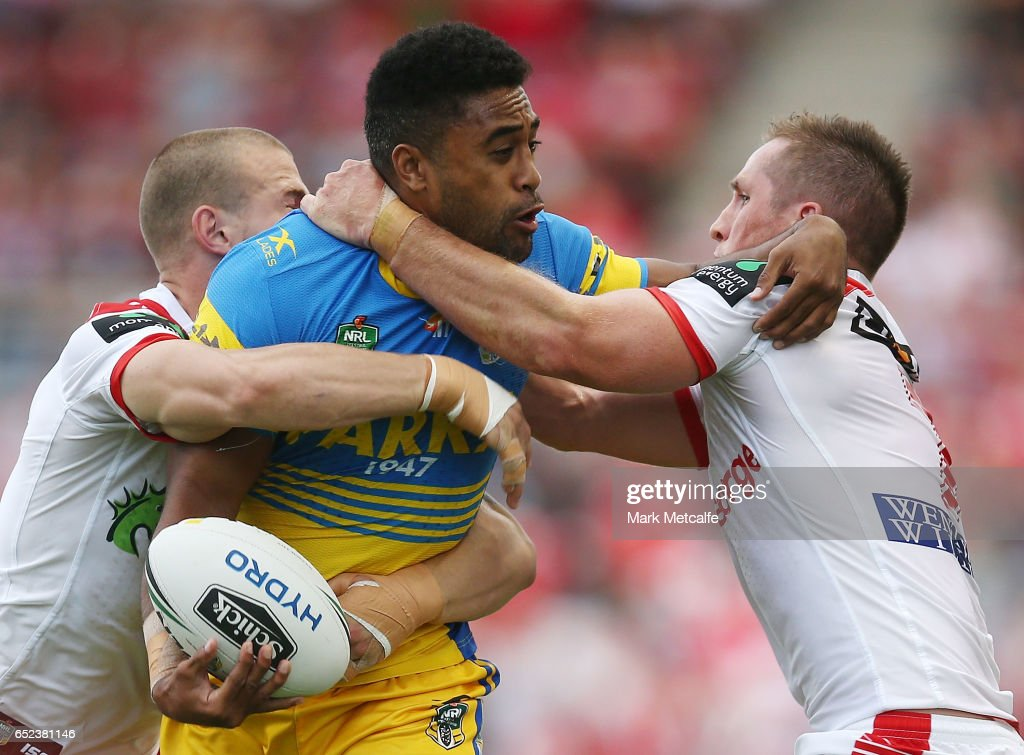 Michael Jennings of the Eels is tackled by Josh McCrone of the Dragons during the round two NRL match between the St George Illawarra Dragons and the Parramatta Eels at WIN Stadium on March 12, 2017 in Wollongong, Australia.